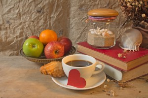 Still life coffee breakfast,apples and old book with seashell de